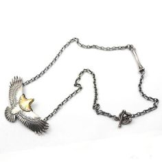 Majestic!  Handcrafted silver and gold eagle charm, on a slim silver chain.   The silver eagle necklace is a beautiful piece of Native American-themed jewelry.   #handmade #navajo #necklace