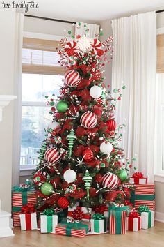 A peppermint Christmas tree decorated with red, white, and green peppermint picks, red mesh ribbon, and oversized ornaments! Grinch Christmas Decorations, Elegant Christmas Trees, Ribbon On Christmas Tree, Christmas Tree Design, Noel Christmas, Green Christmas, Christmas Tree Ideas, Christmas Christmas, How Decorate Christmas Tree