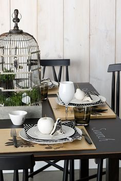 Paint an old table with chalkboard paint so guests names can be hand drawn next to their place settings.