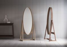 The Iona Tall Cheval is a full-length pivoting elliptical mirror with a shaker-style joint and brass rivet detail at one side on a poised walnut a-frame. The Iona is also offered as a wall hung mirror in various sizes.