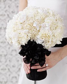 Would not use carnations as pictured, but love the lush texture and black white contrast