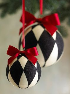 Mackenzie Childs black and white ornaments with a red satin ribbon