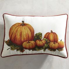 As if they've been freshly picked, our beautifully embroidered pumpkins are ready to enliven your sofa or chair—inside or out. That's right. Our lumbar pillow, made of UV-resistant fabric and trimmed with contrasting piping, can do double duty—sitting pretty in the living room or on the patio. Plus, this group of gourds will look as fresh in early December as they do in October.