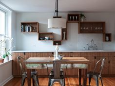 Love the built in cabinets with counter on top.  Workstead Shaded Pendant | Modern Light Fixture