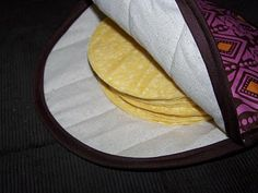 I love this tutorial for a tortilla warmer!  It's part of a housewarming gift set I'm sending my sister-in-law!  She is receiving a couple of lined wine gift bags, coasters, hot pads and this tortilla warmer - all made from chili fabric!