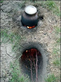 The Dakota Fire Hole is a Native American style fireplace that burns wood efficiently like a wood stove. It is also a safer way to build a fire as it keeps the coals and flames fairly contained when you are trying to have a fire in windy conditions.  By spending some extra effort on digging a Dakota Fire Hole, you can burn a very hot small fire with less wood. Very beneficial in areas where wood is limited. #camping