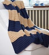 Afghan features a chunky waffle stitch, in alternating large stripes of color. Yarn is held doubled throughout.