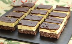 Learn how to make this Canadian treat at home. Nanaimo Bars are a wonderfully rich and creamy treat during the holidays. A Canadian tradition, Nanaimo Bars are a delicious holiday dessert. rich and velvety with just the right amount of chocolate. Nanaimo Bars, Köstliche Desserts, Delicious Desserts, Dessert Recipes, Bar Recipes, Sweet Desserts, Yummy Recipes, Holiday Baking, Christmas Baking