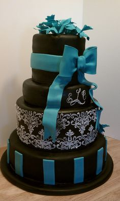 wedding cake idea- teal with mainly black and accent white, or teal with mainly white and accent black?? hmmm...