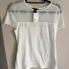 H&M white shirt with lace Super cute shirt . Selling because it's too big on me. Very comfortable material H&M Tops