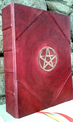 HANDMADE BLANK BOOK OF SHADOWS  Binding: refillable  Leather: natural tanning kalf.  First quality papers: Fabriano, Conqueror, Amatruda  Red leather   400 pages, paper: FABRIA* (Fabriano) , color: ivory  SIZE: 30x22 cm (11,81 x 9,44 inches)  available in: mahogany color, teak (dark brown), red, green, blue, black leather