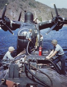 Martin PBM-3 Mariner from Fleet Air Wing One being refueled off Saipan, 1945.