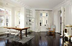 Love the dark floor-light walls combination