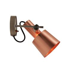 A 1960s inspired design, crafted out of striking satin copper with a stainless steel base. A beautiful yet functional wall light with an attractive cable entry detail. Black cotton braided cable.. Type of fitting: E27. Number of lamps: 1. Lamp: GLS. Maximum wattage: 40. Voltage: . Bulb Supplied: No. Type of glass: No glass. IP Rating : IP20. Dimmable: No