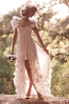 I like the short slip underneath with the long over dress open at the front