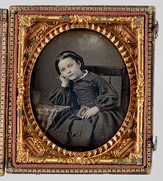 Sixth Plate Daguerreotype of a Girl in mourning  holding a  Daguerreotype of her deceased Sibling.
