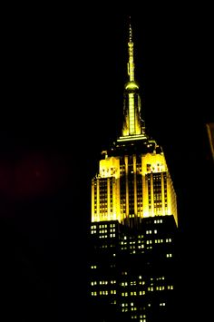 """October 23, 2014: The Empire State Building is lit in brilliant yellow to honor the Afterschool Alliance and its """"Lights On Afterschool"""" campaign."""