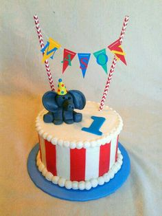 First birthday circus smash cake with super fun elephant and colorful banner!