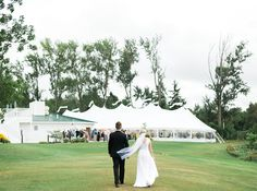 Elegant tent wedding at Horseshoe Bay Golf Club in Egg Harbor, Door County  photo by laurelyn savannah photography
