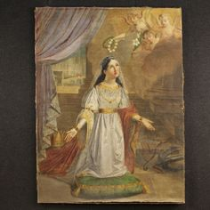 """Price: 4800€ French painting of the second half of the 18th century. Work oil on canvas, first canvas depicting the subject of sacred art """"Holy Martyr with angels"""". Painting that propose in the central scene the figure of the life-size martyr with angels at the top right. On the sides of the female figure there are a crown, weapons and instruments of torture. On the left background is represented the sad end of the martyr who died drowned. #antiques #parino Visit our website www.parino.it"""