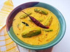 Salan is an accompaniment which is usually had with the Biryani's. There are several types of salan, the most common being mirchi ka salan. Here, we have used tindora or Ivy Gourds to make the salan. Ivy gourds have many nutritional benefits. It is highly beneficial for the diabetic patients as it contains the natural insulin to lower the sugar level in the body. The freshly made salan masala adds a nutty taste to the dish. Serve the Tindora Ka Salan Recipe along with Paneer Bir... Mirchi Ka Salan, Paneer Biryani, Tamarind Juice, Indian Food Recipes, Ethnic Recipes, Sugar Level, The Dish, Gourds, Gravy