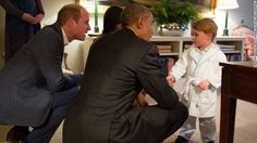 President Barack Obama, Prince William, left, and first lady Michelle Obama talk with Prince George at Kensington Palace on Friday, April 22 in London.