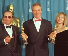 "Clint Eastwood holds up his two Oscars at the annual Academy Awards. He won for Best Director and Best Picture for ""Unforgiven,"" Eastwood poses with presenters, actor Jack Nicholson and entertainer Barbra Streisand. Best Actress Award, Best Actor, Jack Nicholson, Hooray For Hollywood, Old Hollywood, Classic Hollywood, Oscar Photo, Denis Villeneuve, Barbra Streisand"