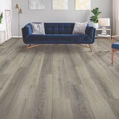 Brown, light medium wood-look flooring. Pergo Extreme Wood Originals in Tea Party