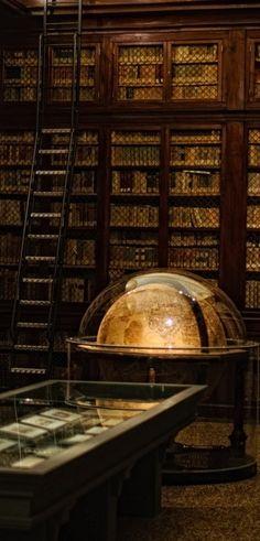 Old globe in the library of the Istituto delle Scienze, Palazzo Poggi, Bologna, Italy
