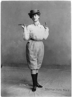 An American Gilded Age fashioned lady in a photographic pose. She is wearing a horseback riding ensemble, while holding a riding crop, c.1901. ~ {cwl} ~ (Image/collection: LOC)