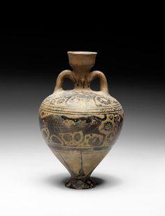A Corinthian pottery amphoriskos. Attributed to the Japigia Painter, circa 560-550 B.C.