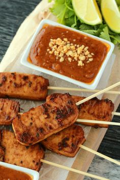 Crispy baked tofu satay served with peanut sauce. This high-protein appetizer is marinaded and then baked for the most deliciously flavored tofu experience. Gluten-Free optional! #vegan #lovingitvegan #appetizer #tofu #glutenfree | lovingitvegan.com