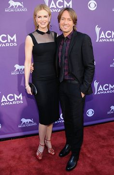 "Oscar-winning actress Nicole Kidman cozied up to her country music star husband Keith Urban. While the ""Moulin Rouge"" star is often panned for her fashion choices, in this case, everything but her footwear gets our seal of approval."