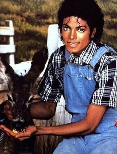 MJ Thriller era; MJ with animal attire: Baby blue overalls and multi color black and white design shirt