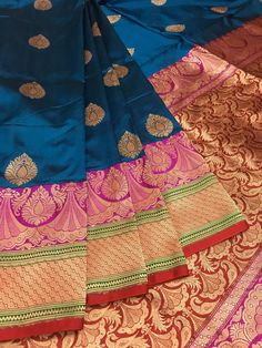 End your search here. Be it bridal or party wear, IndyVogue has endless choice for you. Buy this pure katan silk Banarasi Saree in Cerulean Blue, Hot Pink (border) and Red (pallu) combination. Intricate Gold Zari weaving add a royal feel to your attire. Kanjivaram Sarees Silk, Kanchipuram Saree, Pure Silk Sarees, Designer Sarees Wedding, Wedding Silk Saree, Organza Saree, Chiffon Saree, Onam Saree, Sari Dress