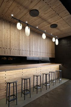 Bar and ceiling of same material- defining the bar area and creating area specific lighting. could have framed out shelving and cabinetry on rear wall above counter. pendant lighting integrated above bar area. Gala Chandelier by Rich, Brilliant, Willing. Deco Restaurant, Restaurant Interior Design, Cafe Interior, Modern Restaurant, Coffee Shop Design, Cafe Design, Store Design, Design Design, Design Ideas