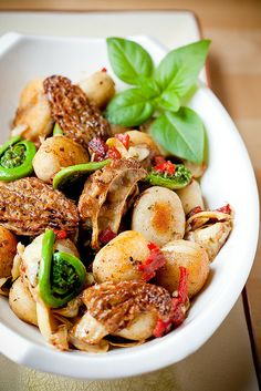Pan-Fried Gnocchi with Morels and Fiddleheads by teenytinyturkey, via Flickr