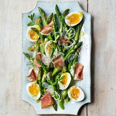 This impressive-looking asparagus salad recipe is actually very easy to make. After quickly boiling the asparagus, the same water is used to soft-boil the eggs.
