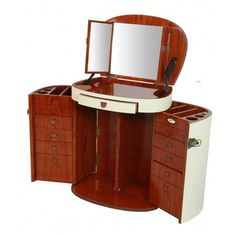 This is pretty cool!  Marie Galante Makeup Trunk in Rosewood. 2 half-moon doors featuring drawers. 1 central storage. 2 secret compartments. Flip-up top for a triptych mirror. Leather trimmed. Small wheels. Ivory ostrich style outer covering.