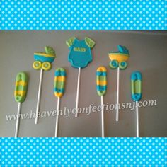 Blue, yellow, and green baby shower lollipops