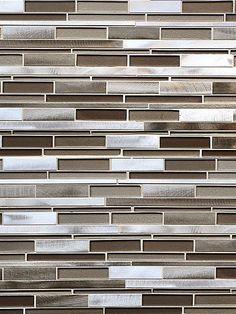 Brown glass tiles mixed with brown metals and gray metal tiles to create subway mosaic backsplash tile.