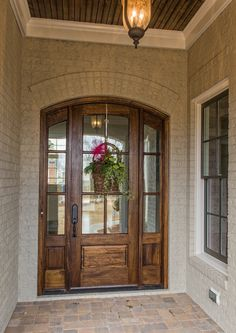 Beautiful wooden arched door at this custom built home in Greenville, SC. GoodwinFoust.com Custom Home Builder - Greenville, SC