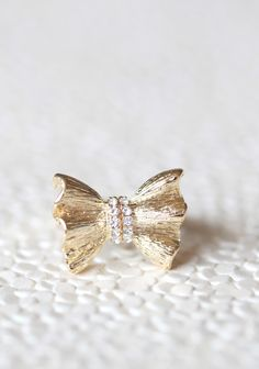gold colored bow ring