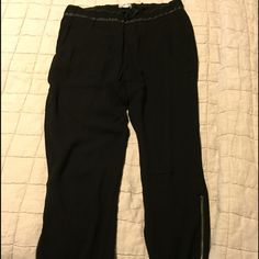 Cropped athleisure-styles pant w/leather detailing Black cropped pant, drawstring waist with leather detailing. Zipper accents at calf.  LOVED THIS PANT - it just sadly no longer fits. Helmut Lang Pants Ankle & Cropped