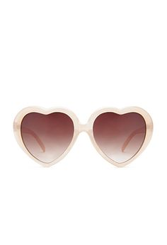 A pair of rosy-lensed sunglasses with heart-shaped frames so sweet, they'll make yours flutter