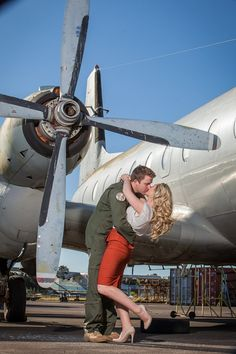 Vintage Airforce Inspired Engagement @Jenna Hays We'd just have to find an old looking airplane back drop but this could be cute!