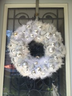 Christmas wreath DIY dollar store materials  Wire hanger, Christmas balls, feather boa, hot glue