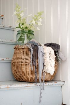 basket with scarves for the guests to come out in cold nights at dinner parties