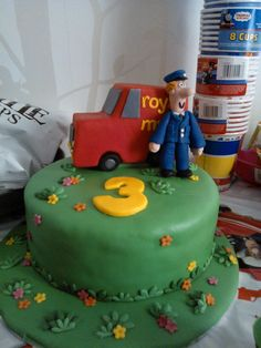 Postman Pat cake for 3rd birthday party. I used marshmallow crispie cake for the van, and three layer choc cake with vanilla buttercream for the cake. Used flower cutter to make the grass leaves, and cut them in half.