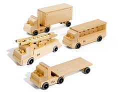 Community Playthings Set of Four Big Trucks (semi, flatbed, fire truck and bus)